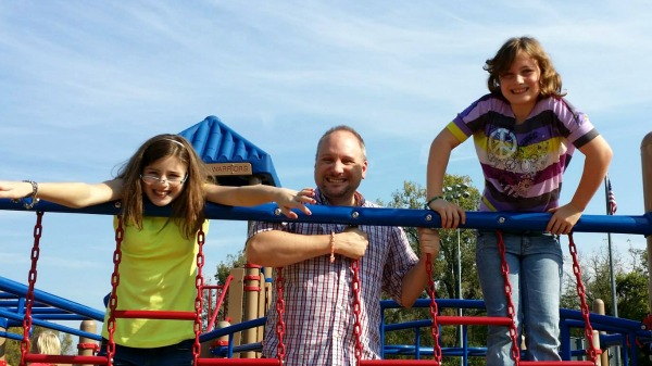 Mykl hanging out (literally) with Tillie & Lucy at the park last fall.