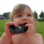 Baby chewing cell phone